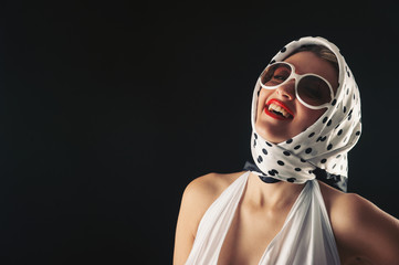 Retro woman with sunglasses laughing fashion portrait