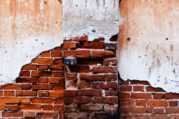 old brick wall with cracked stucco layer background