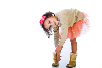 Young girl putting on her boots