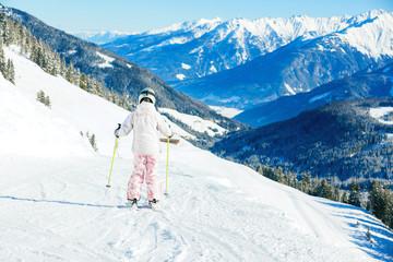 Little girl skiing downhill