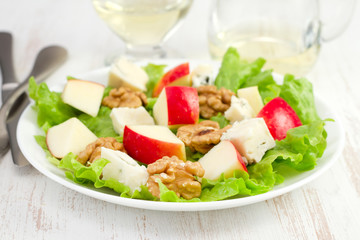 cheese salad with nuts and apple on the plate