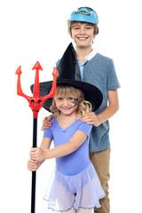 Boy and girl wearing halloween costume