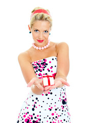 Pin-up portrait of woman with a gift. Isolated on white.