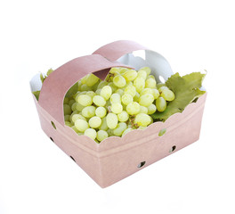 delicious white grapes in basket isolated