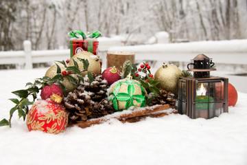 Candle light, christmas balls, cinnamon and pine cones