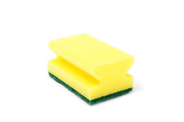 A kitchen sponge isolated against white background