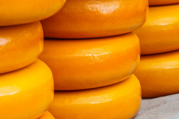Stacks of Dutch cheese on a market