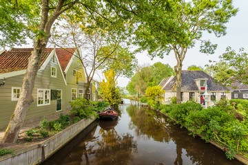 View at a canal in the Dutch historic village Broek in Waterland