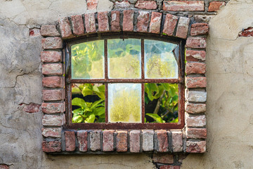Ancient farm window with broken glass