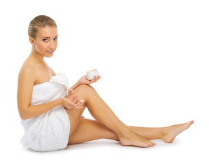 Young healthy girl applying body cream