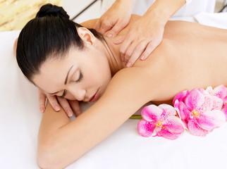 Woman on healthy massage of body in beauty salon