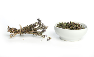 Dried thyme in a bowl and thyme twigs