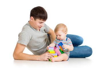 baby boy and father playing together isolated on white