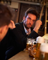 Young businessman drunk in pub