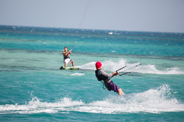 Kiteboarders enjoy surfing