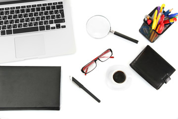 office supply and laptop isolated on white