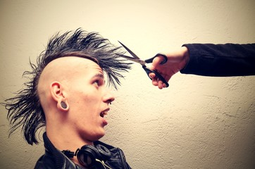 Punk man with mohawk haircut.