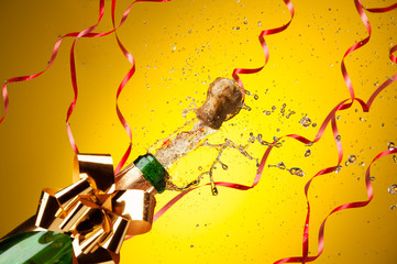 Champagne splashes from just opened bottle