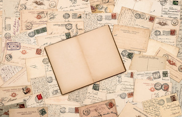 vintage background with old handwritten postcards