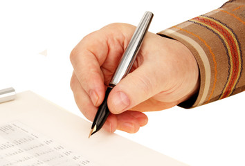 hand with a pen. signature on the document.