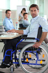 Man in wheelchair on laptop