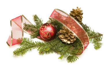 Christmas Ornaments, Pine Cones, Red Ribbon and Pine Branches on