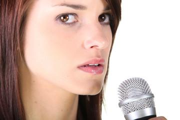 Brunette stood holding microphone