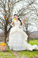Bride posing in the park. Stylized Wedding in oranges