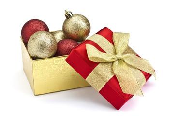 Festive gift box and christmas balls  isolated on white backgrou