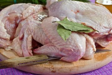 Fresh raw chicken on wooden board