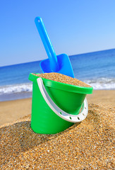 Baby bucket with sand and a shovel