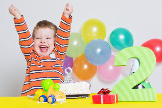 Adorable little boy celebrating second birthday