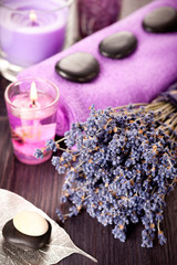 Lavender spa and zen stones on a vintage wooden background