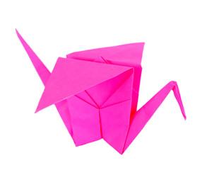 Origami crane on purple background.