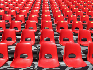 Red chairs of empty stadium but ready to accommodate the fans