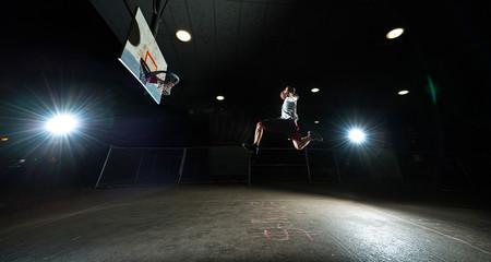 Basketball player at night