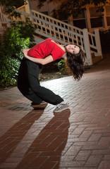 Girl breakdancing at night
