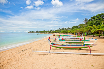 Beautiful tropical beach with fisherman's boats in Nusa Dua on B