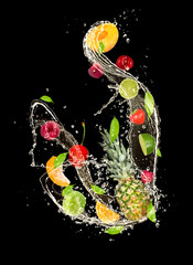 Wall Mural -  Fresh fruits falling in water splash on black background