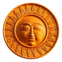 Golden sun figurine isolated on white