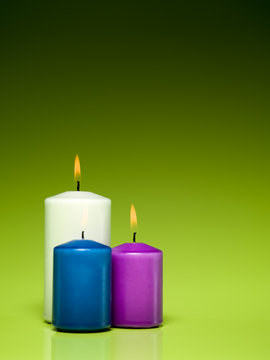 burning colorful wax candles