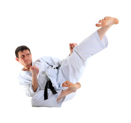 Karate jump against white background
