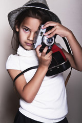 Little girl with a vintage camera