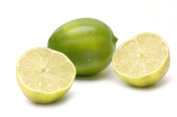 Lime and Sliced Lime Half on White background