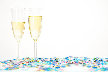Celebration with a glass of champagne and confetti
