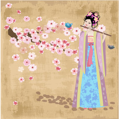 Wall Mural - Beautiful Oriental girl near cherry blossoms