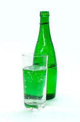 green glass bottle with mineral water , isolated on white backgr