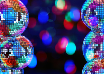 Colorful dark background with mirror disco balls