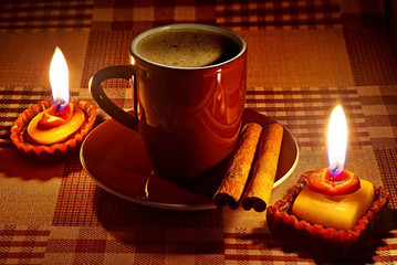 Cup of coffee in natural candle lighting