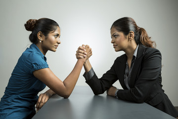 Business women fighting for control.